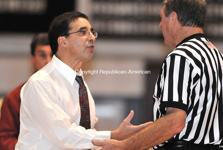 TORRINGTON, CT- 06 JANUARY 2009 --010609JS13-Torrington head coach Tony Turina quastions a traveling call with a referee during their game against Naugatuck Tuesday at Torrington. <br /> Jim Shannon / Republican-American