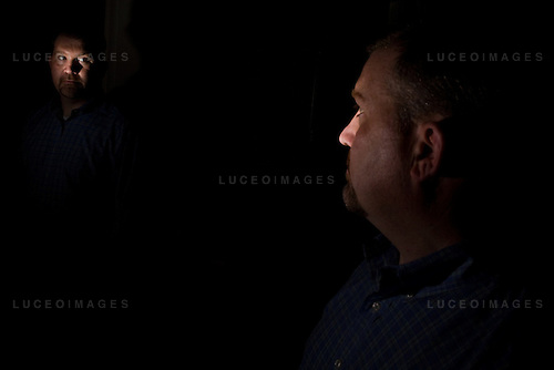 Matthew Crabtree, a Lost Angeles-based certified fraud investigator, poses for portraits at his parents' home near Denver, Colo.
