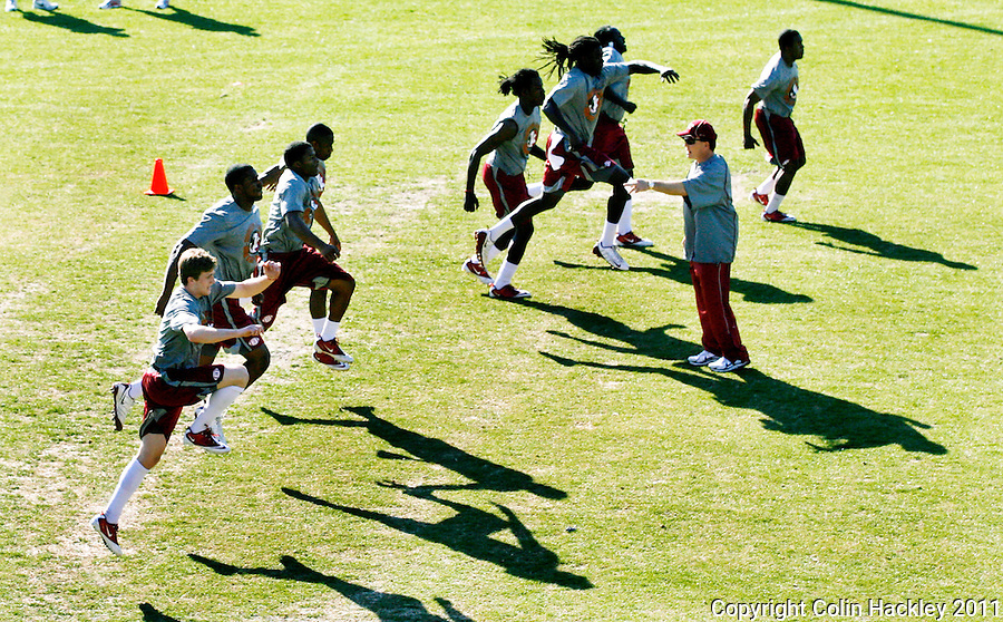 TALLAHASSEE, FL 2/18/11-FSUPRACTICE021811 CH-Florida State Head Coach Jimbo Fisher urges his players on during practice Friday in Tallahassee. COLIN HACKLEY PHOTO