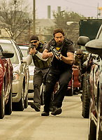 Den of Thieves (2018) <br /> Maurice Compte and Gerard Butler <br /> *Filmstill - Editorial Use Only*<br /> CAP/FB<br /> Image supplied by Capital Pictures