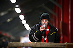 © Joel Goodman - 07973 332324 . 14/11/2015 . Manchester , UK . A supporter drinking pre-match at a newly-constructed bar , underneath the St Mary's Road end terrace . FC United host Gainsborough Trinity in the National League North at Broadhurst Park . NB requested changing room access three times and was denied three times . Photo credit : Joel Goodman