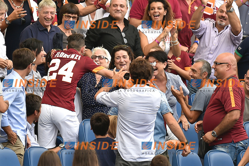 Esultanza Alessandro Florenzi dopo il gol Roma 2-0 Goal celebration Corsa in tribuna ad abbracciare la Nonna . With the grandmother <br /> Roma 21-09-2014 Stadio Olimpico, Football Calcio Serie A AS Roma - Cagliari. Foto Andrea Staccioli / Insidefoto