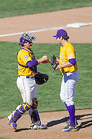 LSU Tigers starting pitcher Alex Lange (35) celebrates the win with catcher Kade Scivicque (22) after the NCAA College baseball World Series against the Cal State Fullerton on June 16, 2015 at TD Ameritrade Park in Omaha, Nebraska. LSU defeated Fullerton 5-3. (Andrew Woolley/Four Seam Images)