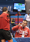 November 14 2011 - Guadalajara, Mexico: Martin Pelletier receiving instructions from his coach John MacPherson competing in Table Tennis at the 2011 Parapan American Games in Guadalajara, Mexico.  Photos: Matthew Murnaghan/Canadian Paralympic Committee