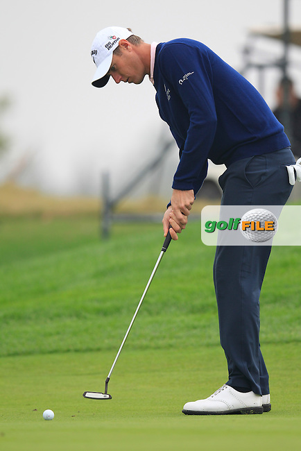 Nicolas Colsaerts (BEL) putts on the 1st green during Saturay's Round 3 of the 2014 BMW Masters held at Lake Malaren, Shanghai, China. 1st November 2014.<br /> Picture: Eoin Clarke www.golffile.ie
