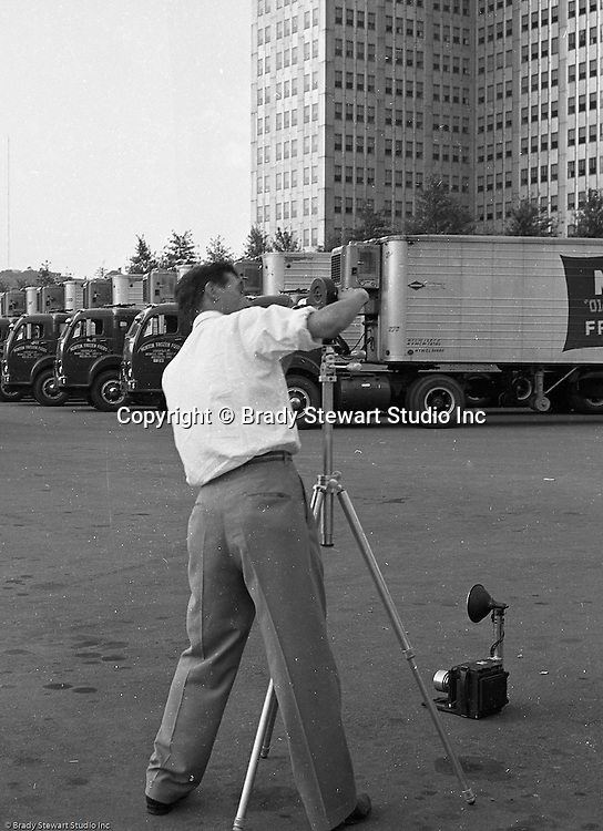 Pittsburgh PA:  Brady Stewart Studio on location for Morton Frozen Pies at Gateway Center in downtown Pittsburgh - 1957.  Assignment was for Ketchum McLeod and Grove Advertising. Brady Stewart Jr. and Ross Catanza handled the unique assignment.  View of Ross Catanza preparing to shoot a 16mm film for the assignment.
