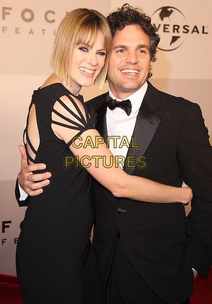 SUNRISE COIGNEY & MARK RUFFALO.NBC Universal 68th Annual Golden Globe Awards After Party held at the Beverly Hilton, Beverly Hills, California, USA..January 16th, 2011.half length black dress tuxedo married husband wife side hug embrace.CAP/ADM/CH.©Charles Harris/AdMedia/Capital Pictures