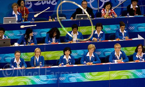 24 AUG 2008 - BEIJING, CHN - Judges watch a display during the Team Rhythmic Gymnastics - Day Sixteen - Beijing Olympics. (PHOTO (C) NIGEL FARROW) *** IOC RULES APPLY ON USAGE ***