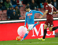 Napoli's Elseid Hysaj kicks t during the  italian serie a soccer match,between SSC Napoli and Torino      at  the San  Paolo   stadium in Naples  Italy , January 07, 2016