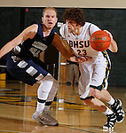 SPEARFISH, SD - DECEMBER 15, 2013:  Tommy Earl #23 of Black Hills State dribbles into pressure from Trevor Ritchie #20 of Colorado Mines during their Rocky Mountain Athletic Conference game Sunday afternoon at the Donald E. Young Center in Spearfish, S.D.  (Photo by Dick Carlson/Inertia)