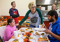 NWA Democrat-Gazette/BEN GOFF @NWABENGOFF<br /> Chris Schaefer (center), a volunteer from Bella Vista, serves the family of Felix Soto, Hollie Rea, Dylan Rea, 6, and Maddison Rea, 9, Thursday, Nov. 28, 2019, during the community Thanksgiving meal at the Salvation Army Emergency Shelter in Bentonville. The shelter served residents and community members in need from 11 a.m. to 2 p.m.