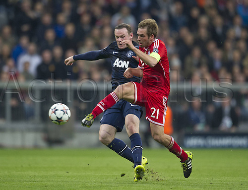 09.04.2014. Munich, Germany, Allianz Arena. UEFA Champions league quarterfinal, second leg. Bayern Munich versus Manchester United. Philipp LAHM (M) and Wayne ROONEY (MAN)