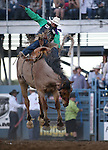Joaquin Real competes in the saddle bronc event at the Reno Rodeo in Reno, Nev., on Thursday, June 27, 2013.<br /> Photo by Cathleen Allison