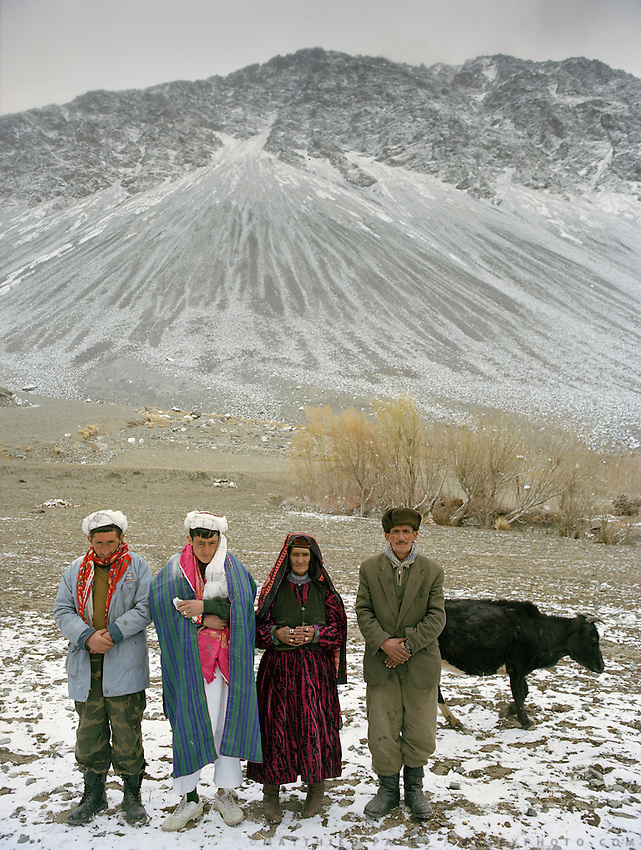 Left to Right: Shogun Baig (is best man), Dodé Khuda, mother (Sabik), father (Ghalum), family cow..Wedding celebration of Dodé Khuda, at Safar Boi house, in Tchehel-Kand village..Wakhi wedding ceremonies usually takes place in the winter months. The Wakhi do most of their business with Afghan Kyrgyz..Winter expedition through the Wakhan Corridor and into the Afghan Pamir mountains, to document the life of the Afghan Kyrgyz tribe. January/February 2008. Afghanistan