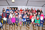 Children from Knockaderry NS who sang Carols as they waited for Santa at Farranfore Garda station on Sunday