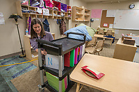 NWA Democrat-Gazette/ANTHONY REYES @NWATONYR<br /> Elizabeth Hill, upper elemenary teacher at Ozark Montessori Academy moves students' files Monday, May 1, 2017 from her original classroom at the Ozark Montessori Academy in Springdale. Recent heavy rains forced the basement level classrooms to be moved to upper floors. The school was closed Monday to make the move.