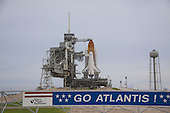 """Space shuttle Atlantis is revealed on Launch Pad 39A at NASA's Kennedy Space Center in Cape Canaveral, Florida following the move of the rotating service structure (RSS) on July 8, 2011. The structure provides weather protection and access to the shuttle while it awaits liftoff on the pad. RSS """"rollback"""" marks a major milestone in Atlantis' STS-135 mission countdown. In front of the pad a banner proclaims the sentiments of Kennedy's work force. Atlantis and its crew of four; Commander Chris Ferguson, Pilot Doug Hurley and Mission Specialists Sandy Magnus and Rex Walheim, are scheduled to lift off at 11:26 a.m. EDT on July 8 to deliver the Raffaello multi-purpose logistics module packed with supplies and spare parts to the International Space Station. Atlantis also will fly the Robotic Refueling Mission experiment that will investigate the potential for robotically refueling existing satellites in orbit. In addition, Atlantis will return with a failed ammonia pump module to help NASA better understand the failure mechanism and improve pump designs for future systems. STS-135 will be the 33rd flight of Atlantis, the 37th shuttle mission to the space station, and the 135th and final mission of NASA's Space Shuttle Program. .Mandatory Credit: Troy Cryder / NASA via CNP"""