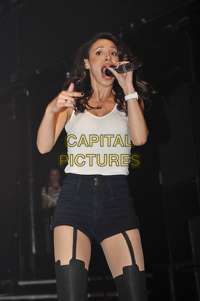 Amelle Berrabah.performing at the SBTV Christmas Party, Koko, Camden, London, England..21st December 2011.on stage in concert live gig performance half length black white stockings hold ups shorts tank top singing funny.CAP/MAR.© Martin Harris/Capital Pictures.