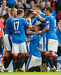 Rangers players celebrate with Daniel Candeias