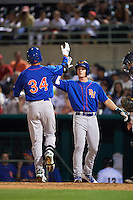 Midland RockHounds third baseman Matt Chapman (7) high fives Viosergy Rosa (34) after a home run during a game against the San Antonio Missions on April 22, 2016 at Nelson W. Wolff Municipal Stadium in San Antonio, Texas.  San Antonio defeated Midland 8-4.  (Mike Janes/Four Seam Images)