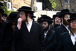 Ultra Orthodox Jewish men attend a demonstration against the arrest of six Ultra Orthodox Jews suspected of tax evasion in the Meah Shearim Neighborhood, Jerusalem, 15 January 2012. Reports state that three men were arrested after they shouted 'Nazis' at police officers during the demonstration against the arrest of six Ultra Orthodox Jews who are allegedly implicated in a financial scandal and are suspected of tax evasion. Photo by Mahfouz Abu Turk