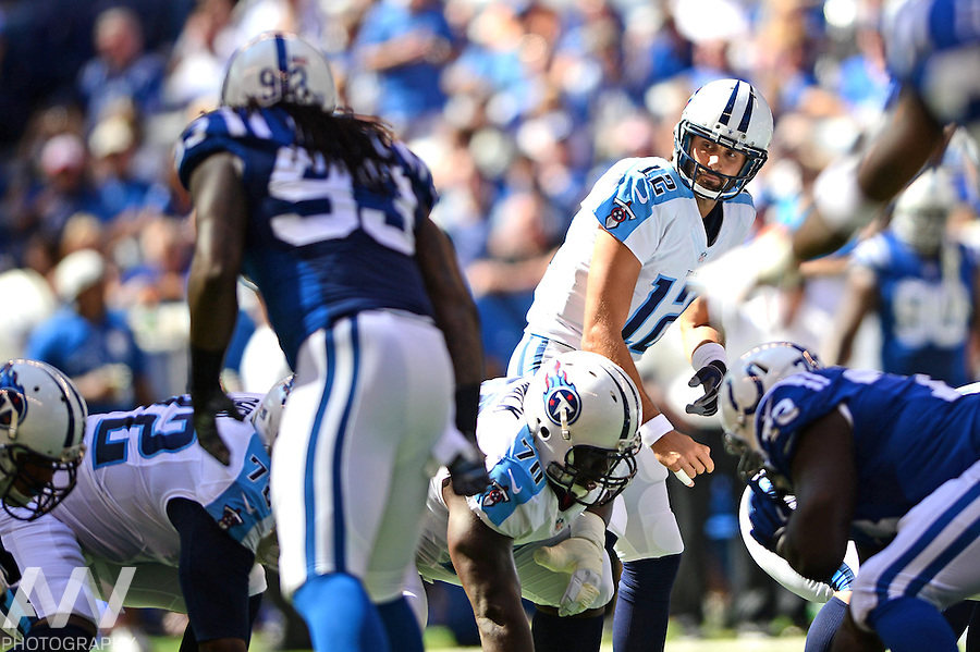 Sep 28, 2014; Indianapolis, IN, USA; Tennessee Titans quarterback Charlie Whitehurst (12) takes a snap from center during the second quarter against the Indianapolis Colts at Lucas Oil Stadium. Mandatory Credit: Andrew Weber-USA TODAY Sports