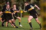 M. McKinnon  has J. Biggelaar in support as he heads upfield. Counties Manukau Premier club rugby game between Bombay & Pukekohe played at Bombay on the 19th of May 2007. Pukekohe led 24 - 0 at halftime & went on to win 30 - 22.