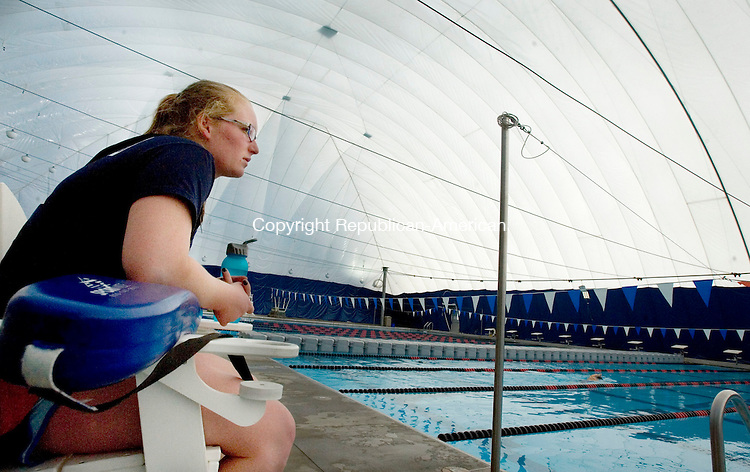 CHESHIRE, CT. 13 February 2012-021312SV02-Lifeguard Caitlyn O'Connor of Wallingford watches over swimmers at the community pool in Cheshire Monday. The pool at Bartlem Park is finally open to the public. It did not have a bubble for more than a year, after the old one was damaged during a snowstorm in January 2011..Steven Valenti Republican-American
