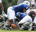 30 September 2006: Duke quarterback Thaddeus Lewis (9) fumbles the ball on fourth and short in the first quarter. The Duke University Blue Devils lost 37-0 to the University of Virginia Cavaliers at Wallace Wade Stadium in Durham, North Carolina in an Atlantic Coast Conference NCAA Division I College Football game.