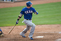 "Texas Rangers center fielder Josh Hamilton #32 follows through on his first home run of the spring during the MLB exhibition baseball game against the ""AAA"" Round Rock Express on April 2, 2012 at the Dell Diamond in Round Rock, Texas. The Rangers out-slugged the Express 10-8. (Andrew Woolley / Four Seam Images)."
