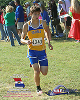 Fatima Sr. Tom Zeilman runs to victory in the 1A-2A Varsity Boys race in 17:32 at the 2013 Hancock XC Invitational.