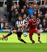 1st October 2017, St James Park, Newcastle upon Tyne, England; EPL Premier League football, Newcastle United versus Liverpool; Daniel Sturridge of Liverpool and Mikel Merino of Newcastle United battle for the ball in the 1-1 draw