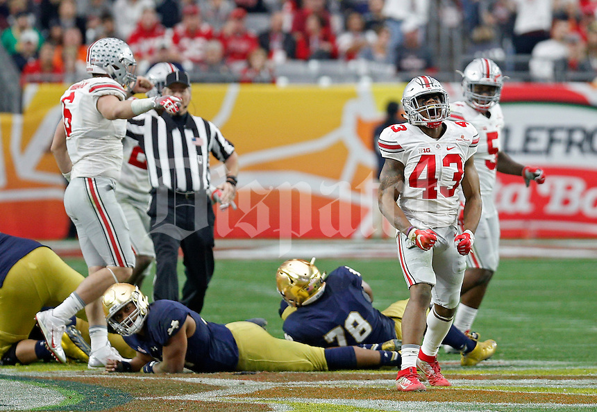 Ohio State Buckeyes linebacker Darron Lee (43) celebrates after he caused Notre Dame Fighting Irish quarterback DeShone Kizer (14), on ground left, to fumble and was recovered by Ohio State Buckeyes in the fourth quarter during the Fiesta Bowl in the University of Phoenix Stadium on January 1, 2016.  (Dispatch photo by Kyle Robertson)