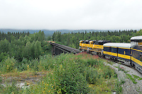 The Denali Star approaches the bridge over Hurricane Gulch. The Alaska Railroad's Denali Star train runs between Anchorage and Fairbanks, with Denali one of the stops along the way.