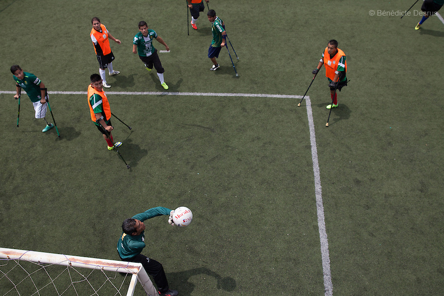 "Martin Alvarez Olvera, goalkeeper of Guerreros Aztecas, stretches to claim an attempt on goal during a soccer game in Mexico City, Mexico on September 13, 2014. Martin, 49, lost his left arm to a disease of the nerves. He is currently unemployed. Guerreros Aztecas (""Aztec Warriors"") is Mexico City's first amputee football team. Founded in July 2013 by five volunteers, they now have 23 players, seven of them have made the national team's shortlist to represent Mexico at this year's Amputee Soccer World Cup in Sinaloa this December. The team trains twice a week for weekend games with other teams. No prostheses are used, so field players missing a lower extremity can only play using crutches. Those missing an upper extremity play as goalkeepers. The teams play six per side with unlimited substitutions. Each half lasts 25 minutes. The causes of the amputations range from accidents to medical interventions – none of which have stopped the Guerreros Aztecas from continuing to play. The players' age, backgrounds and professions cover the full sweep of Mexican society, and they are united by the will to keep their heads held high in a country where discrimination against the disabled remains widespread. (Photo by Bénédicte Desrus)"