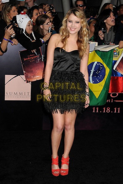 Taylor Spreitler.The Los Angeles premiere of 'The Twilight Saga Breaking Dawn Part 1' at Nokia Theatre at L.A. Live in Los Angeles, California, USA..November 14th, 2011.full length black strapless corset dress feathers skirt red shoes.CAP/ADM/BP.©Byron Purvis/AdMedia/Capital Pictures.