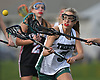Claire Schmitt #31 of Holy Trinity looks to gain possession of a loose ball during a non-league varsity girls lacrosse game against Friends Academy at Holy Trinity High School on Thursday, April 20, 2017. Holy Trinity won by a score of 12-9.