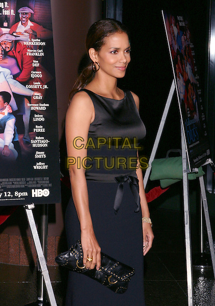 HALLE BERRY .Lackawanna Blues - HBO Screening held at The Directors Guild of America. West Holllywood, California..Photo Credit: Zach Lipp/AdMedia.February 3rd, 2005.half length black sleeveless dress silk satin.www.capitalpictures.com.sales@capitalpictures.com.© Capital Pictures.