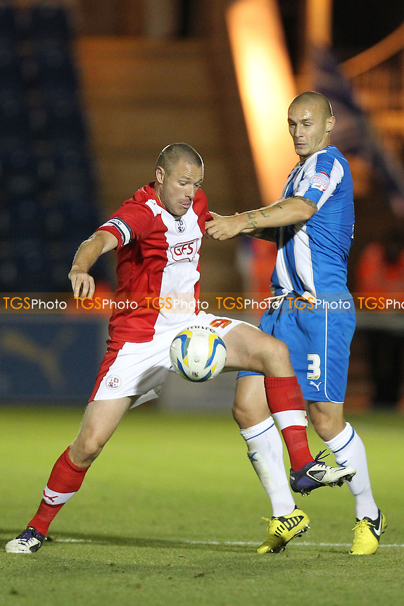 Gary Alexander of Crawley Town and Michael Rose of Colchester United- Colchester United vs Crawley Town - NPower League One Football at the Weston Homes Community Stadium, Colchester, Essex - 18/09/12 - MANDATORY CREDIT: Gavin Ellis/TGSPHOTO - Self billing applies where appropriate - 0845 094 6026 - contact@tgsphoto.co.uk - NO UNPAID USE.