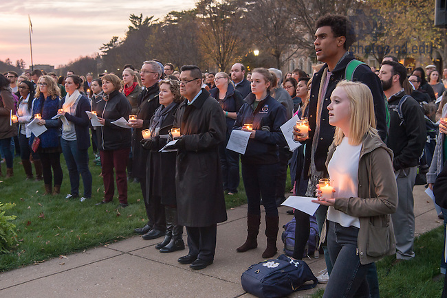 November 14, 2016; Student Body President Corey Robinson (right) participates in the Interfaith Prayer Service for Respect and Solidarity. (Photo by Matt Cashore/University of Notre Dame)