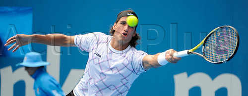 10.01.2011 The Medibank International Tennis series from the Sydney Olympic Park. Feliciano Lopez of Spain attempts to hit a return in his match against Juan Martin Del Potro of Argentina on day two of the 2011 Medibank International at the Sydney Olympic Park Tennis Centre in Sydney, Australia.