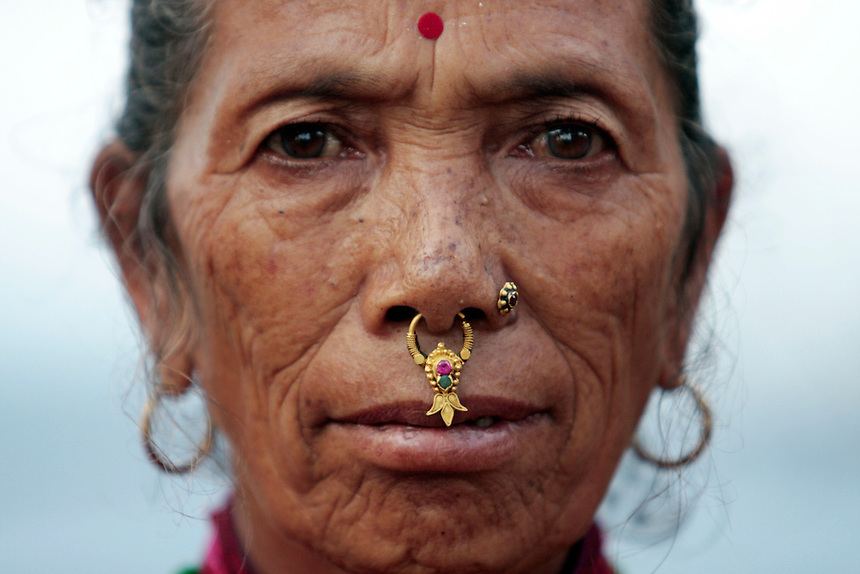 An elderly Nepalese woman with a nose ring in Chaupas Village