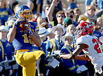 BROOKINGS, SD - OCTOBER 25:  Jake Wieneke #19 from South Dakota State University hauls in a touchdown over Nate Dortch #27 from Youngstown State in the second quarter of their game Saturday afternoon at Coughlin Alumni Stadium in Brookings. (Photo by Dave Eggen/Inertia)