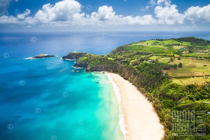 An aerial view of Kauapea Beach close to the Kilauea Lighthouse and Moku`ae`ae Island, North Kaua'i.