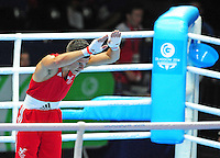 Wales' Joseph Cordina (red) acknowledges the crowd after he defeated England's Pat McCormack (blue) in the men's light (62kg) round of 32<br /> <br /> Photographer Chris Vaughan/CameraSport<br /> <br /> 20th Commonwealth Games - Day 3 - Saturday 26th July 2014 - Boxing - SECC - Glasgow - UK<br /> <br /> © CameraSport - 43 Linden Ave. Countesthorpe. Leicester. England. LE8 5PG - Tel: +44 (0) 116 277 4147 - admin@camerasport.com - www.camerasport.com