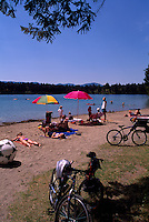 Kikomun Creek Provincial Park, Kootenay Region, BC, British Columbia, Canada - Sunbathing on Beach at Surveyors Lake