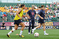 United States (USA) head coach Pia Sundhage watches Angela Hucles (16) and Megan Rapinoe (15) during warmups. The United States (USA) Women's National Team defeated Canada (CAN) 1-0 during an international friendly at Marina Auto Stadium in Rochester, NY, on July 19, 2009.