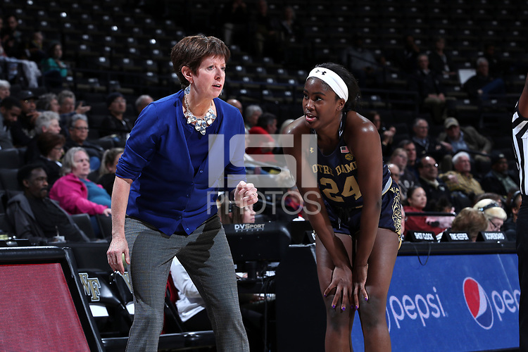 WINSTON-SALEM, NC - FEBRUARY 06: Head coach Muffet McGraw of the University of Notre Dame talks with Destinee Walker #24 during a game between Notre Dame and Wake Forest at Lawrence Joel Veterans Memorial Coliseum on February 06, 2020 in Winston-Salem, North Carolina.