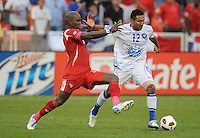 El Salvador Arturo Alvarez (12) run with the ball follow by Panama Felipe Baloy (23)  Panama defeated El Salvador in penalty kicks 5-3 in the quaterfinals for the 2011 CONCACAF Gold Cup , at RFK Stadium, Sunday June 19, 2011.