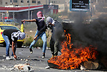 Palestinian protesters clash with Israeli forces in a demonstration against Israel's controversial Jewish nation-state law and Israel's plan to demolish the Palestinian Bedouin village of Khan al-Ahmar, near the Jewish settlement of Beit El in the occupied West Bank city of Ramallah on October 2, 2018. Photo by Shadi Hatem